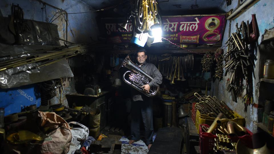 Sabir Ali, a brass instrument maker, poses at his shop in Meerut. Of the city famous for its sports and publishing industry, not many know that 95% of wind instruments — trumpets, euphoniums, bugles, cornets and clarinets used by wedding bands from Kashmir to Kanyakumari — are made in Meerut. An aspiration among musicians, the country's top brass bands come here to source their instruments. (Sanchit Khanna / HT Photo)