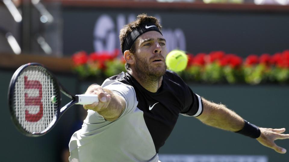 Juan Martin del Potro returns to Roger Federer during the men's final at the BNP Paribas Open tennis tournament on March 18, 2018, in Indian Wells, California.