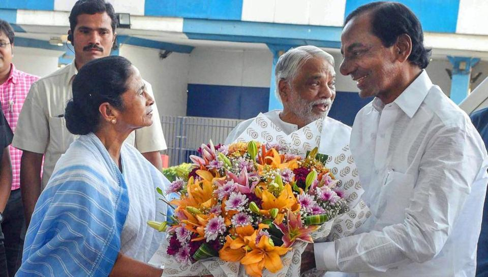 Telangana Chief Minister K Chandrashekhar Rao being welcome by his West Bengal  counterpart Mamata Banerjee ahead of a  meeting in Kolkata on Monday.