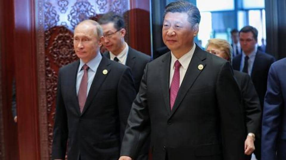 Russia's President Vladimir Putin (L) with Chinese President Xi Jinping attends the Roundtable Summit Phase One Sessions of Belt and Road Forum at the International Conference Center in Yanqi Lake on May 15, 2017 in Beijing, China.