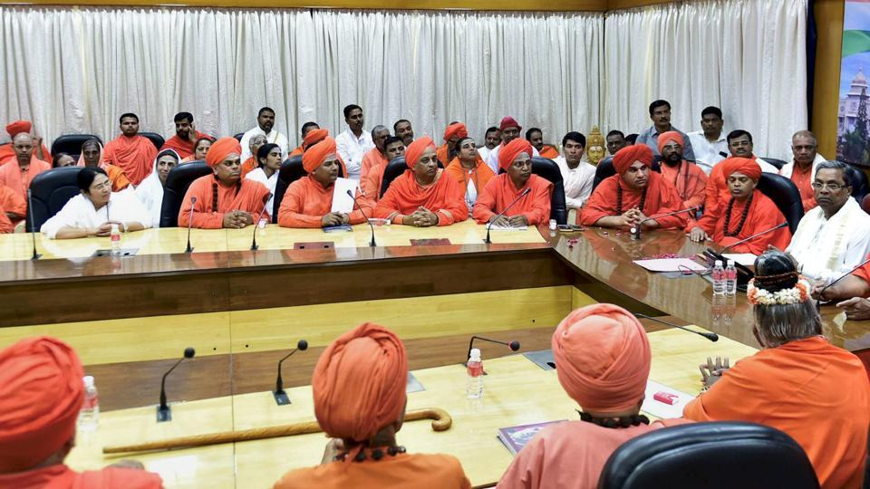 Karnataka chief minister Siddaramaiah meets Lingayat community seers at Vidhana Soudha in Bengaluru on Sunday.