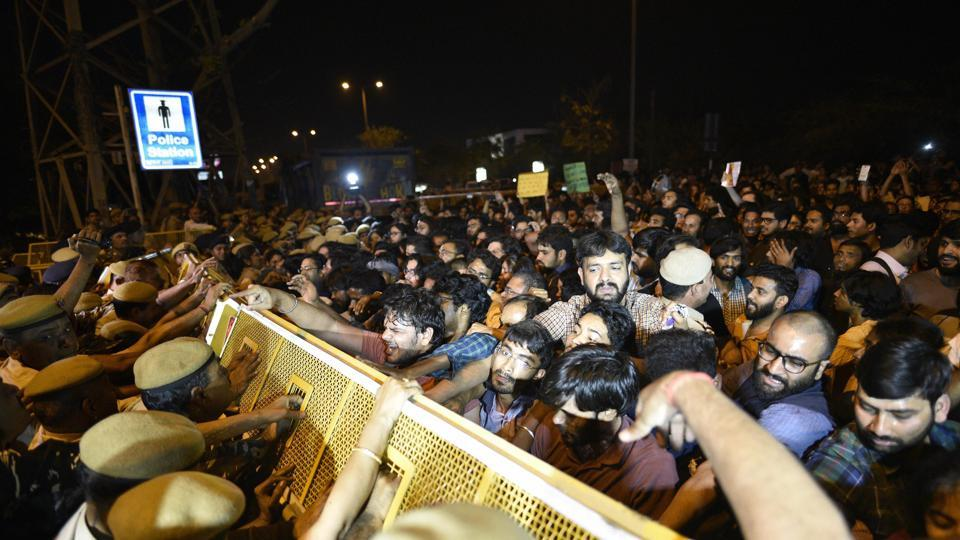 Security personnel stop JNU students during their protest against a professor who is accused of sexually harassing students, at Vasant Kunj police station in New Delhi.