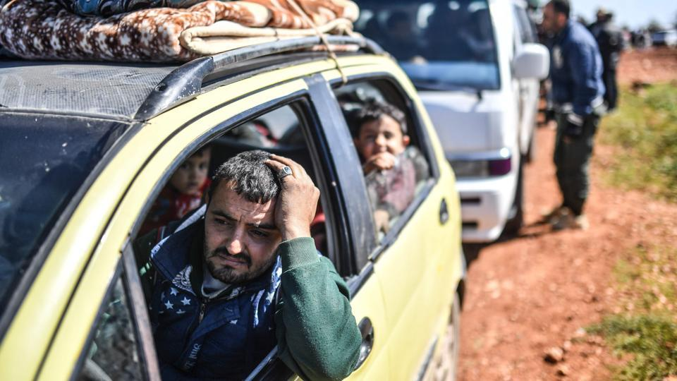 Syrian people arrive at a check point in the village of Anab ahead of crossing to the Turkish-backed Syrian rebels side. Turkish forces and their Syrian rebel allies swept into the northwestern Syrian town of Afrin, raising their flags in the town centre and declaring full control on Sunday after an eight-week campaign to drive out Kurdish YPG forces. More than 200,000 people have fled Afrin in recent days as reported by the Syrian Observatory. (Bulent Kilic / AFP)