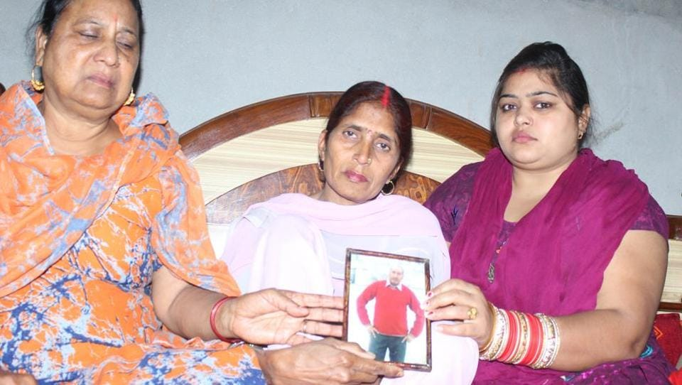 Raj Rani (centre) and her relatives react following confirmation by Sushma Swaraj that her husband Pritpal Sharma had been killed in Iraq. Sharma, a resident of Dhuri (Sangrur), had left his wife and two children, Neeraj Sharma, now 28, and Diksha, 18, to work in Iraq seven years ago (HT Photo)