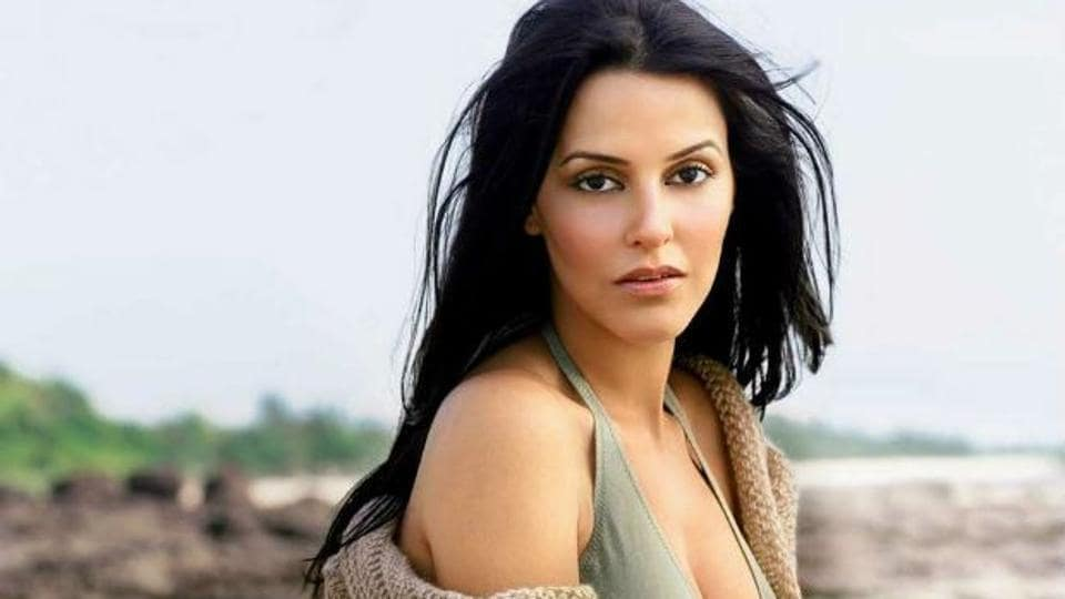 Actor Neha Dhupia says she is not an opportunist, who will wait for the right time to share her views.