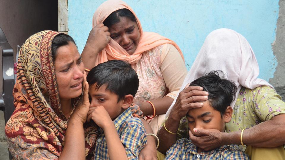Seema (left), her sons Karan (centre) and Arjun and her mother in-law Jeeto (right) react following confirmation by external affairs minister Sushma Swaraj that her husband Sonu had been killed in Iraq. The family lives in Chawinda Devi village, some 22 kilometres from Amritsar.  (Sameer Sehgal/HT)