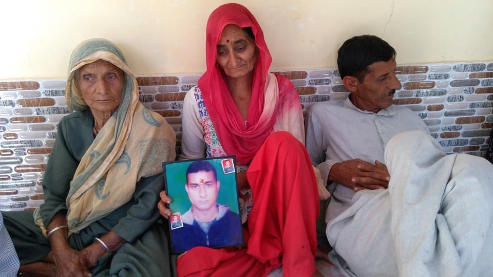 Grandmother, mother (centre) and father of Aman Kumar grieving his death at Passu village near Dharamshala, after Sushma swaraj confirmed he had been killed in Iraq.