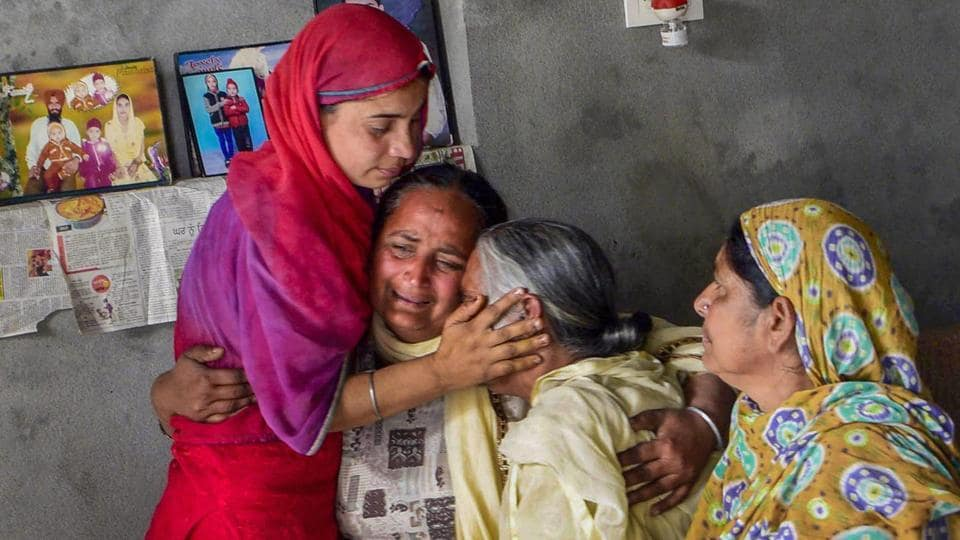 Family members of one of the 39 Indian workers killed in Iraq, grieve at their home on the outskirts of Amritsar on Tuesday.