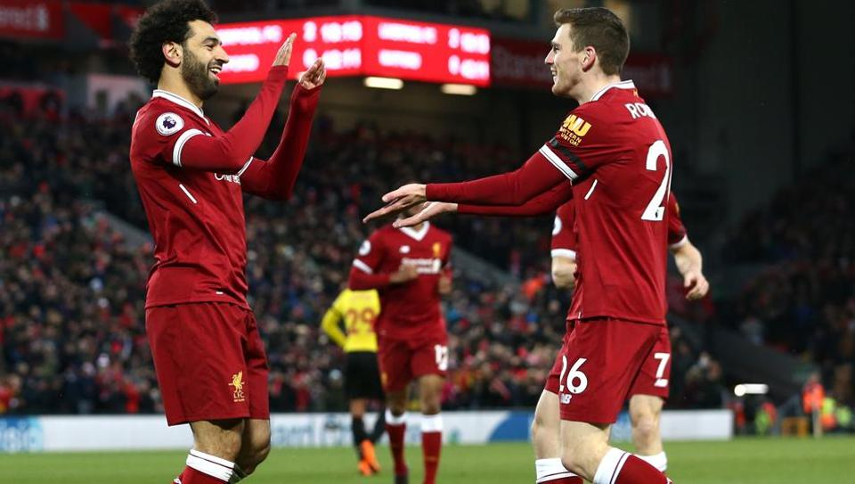 Andy Robertson (R) feels Mohamed Salah is one of the most potent attackers in the world and challenged his Liverpool FC team-mate to kick on and reach the heights achieved by Lionel Messi.