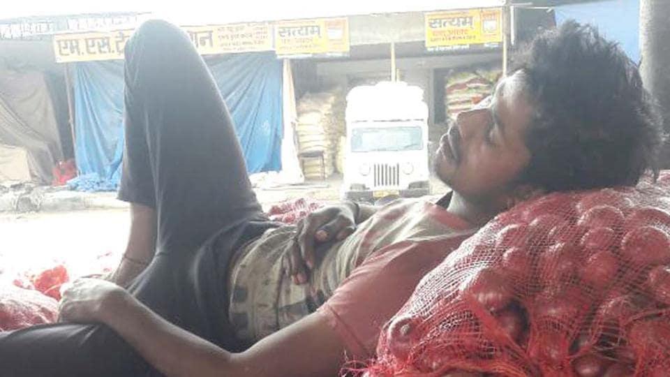 A farmer takes a nap at the mandi in Sikar.