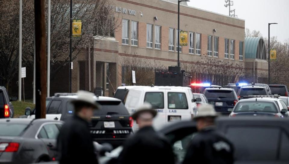 Deputies and federal agents converge on Great Mills High School, the scene of a shooting, on Tuesday.