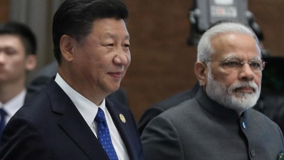 Chinese President Xi Jinping and Prime Minister Narendra Modi at the 2017 BRICS Summit in Xiamen, China.