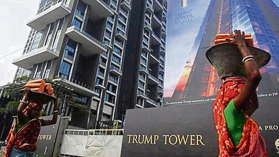 Labourers work on the road leading to the under-construction Trump Tower in Kolkata.