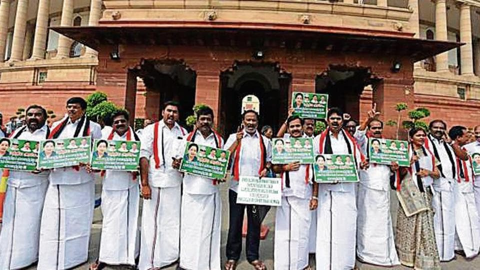 AIADMK leaders raise slogans demanding constitution for Cauvery Management Board in New Delhi on Wednesday.