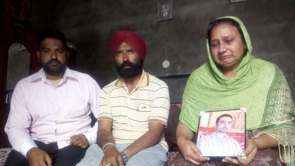 Wife Amarjeet Kaur and other family members of Gobinder Singh, a native of Murar village of Kapurthala district, mourn his death following confirmation by Sushma Swaraj that he had been killed in Iraq, on Tuesday.