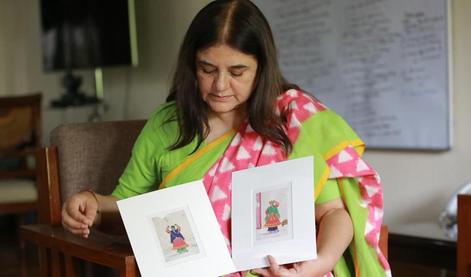 Politician and activist Maneka Gandhi shows two of the mica miniature paintings from her collection, which she is selling to raise money for the animal hospitals under her organisation, People for Animals.