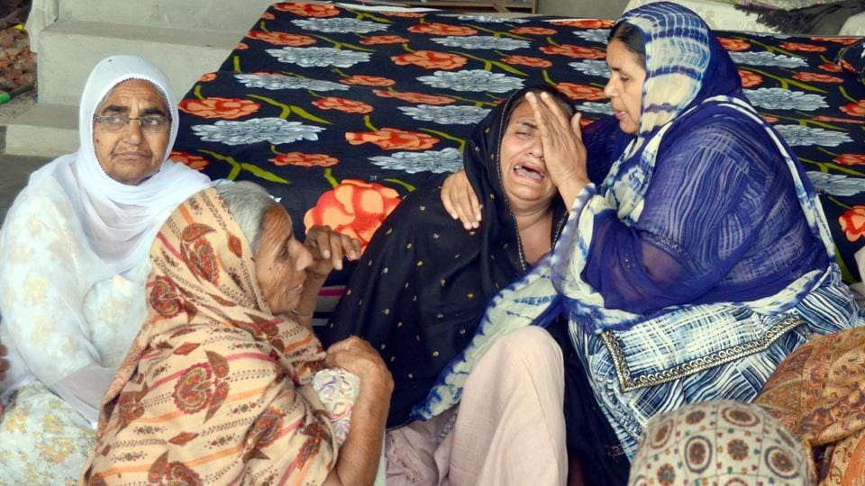 Families gathered at the residence of Manjinder Singh, one of the workers killed in Iraq's Mosul, in Bhoewal village, 30 kms from Amritsar, on Wednesday.