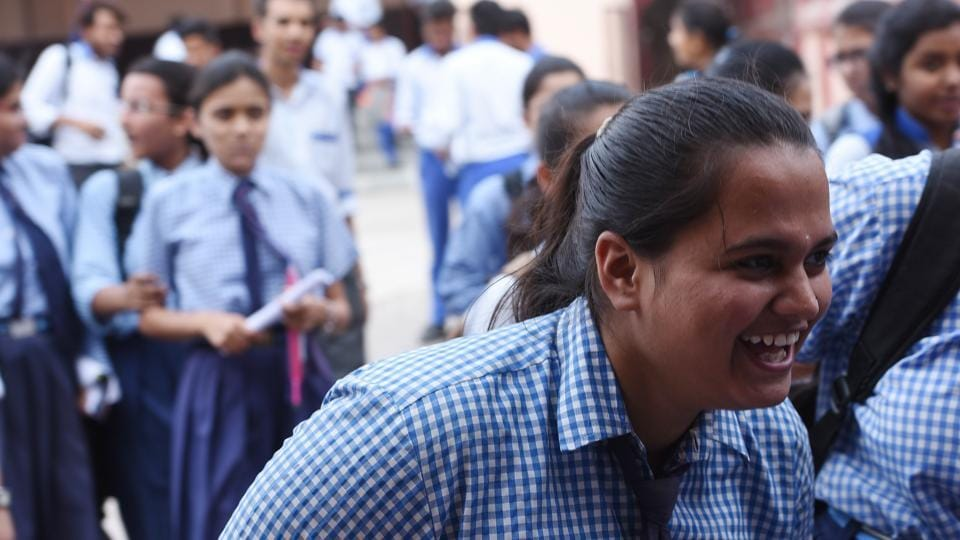 CBSE Class 12 student in happy mood while coming out from the examination centre after appearing in math paper at Cathedral Sr School in Lucknow on Wednesday. (Subhankar Chakraborty/HT PHOTO)