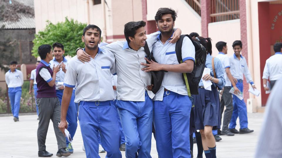 Students of CBSE Class 12 enjoying among themselves while coming out after appearing in their math paper at Cathedral Sr School in Lucknow  on Wednesday.  (Subhankar Chakraborty/HT PHOTO)