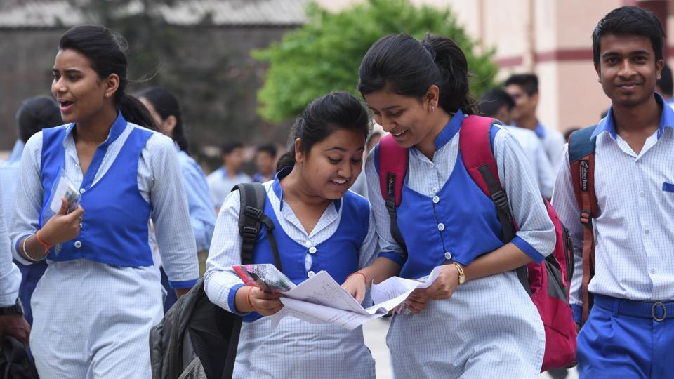 Students of CBSE Class 12 discussing their maths question paper after coming out from the examination centre at Cathedral Sr School in Lucknow on Wednesday.  (Subhankar Chakraborty/HT PHOTO)