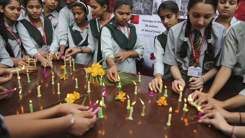 Students participate in a special prayer ceremony at a school in Jammu in honour of 39 missing Indians whose bodies were found buried in a mound near Badush, Iraq. (Channi Anand / AP)