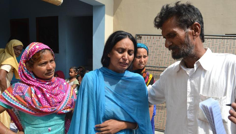 Surjit's widow, Usha (centre), was inconsolable and broke into tears several times following confirmation by Sushma Swaraj that his husband had been killed in Iraq.