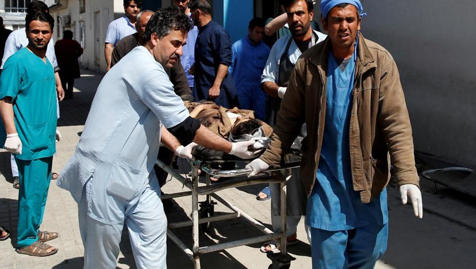 Men transport a victim at a hospital after a blast in Kabul, Afghanistan March 21, 2018.