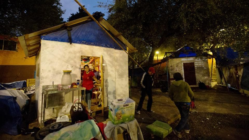 Residents chat outside a shelter in a park, six months after the September 19, 2017 earthquake damaged their housing complex leaving hundreds in housing limbo, waiting for damaged buildings to be either repaired or condemned, in Mexico City. Camps right by their damaged homes, erected by displaced residents are among the most visible signs that not everyone has moved on. (Rebecca Blackwell / AP)