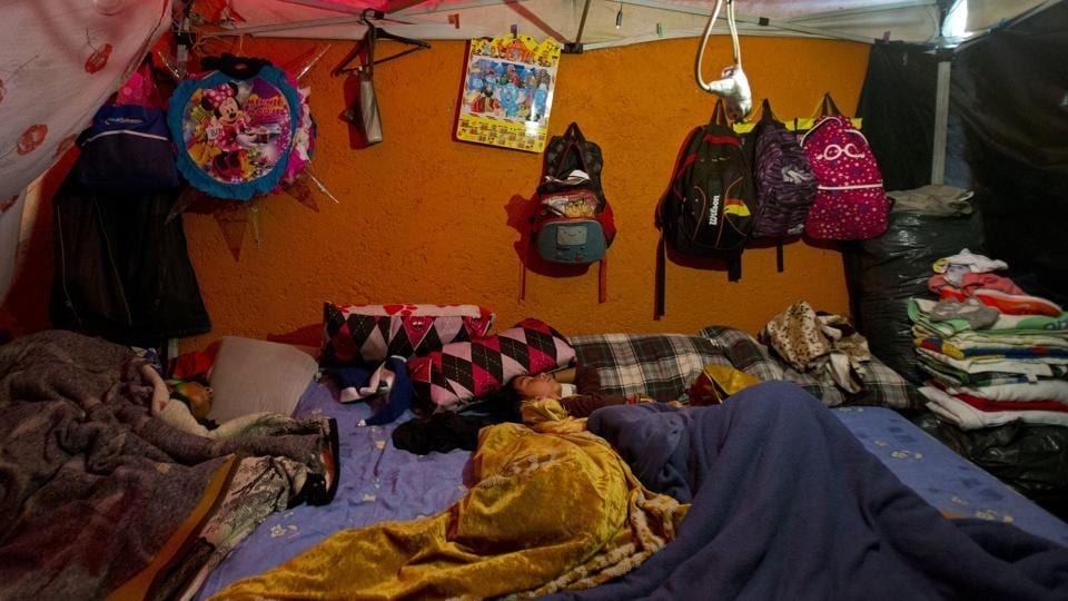 Children sleep in a shelter built against the external wall of a house, in a tent camp outside a damaged building in Mexico City. Despite living on the street, daily life continues, with children attending school and adults heading to work daily. Residents say security in the neighbourhoods is a problem, and one reported occasionally hearing gunshots in the night. (Rebecca Blackwell / AP)