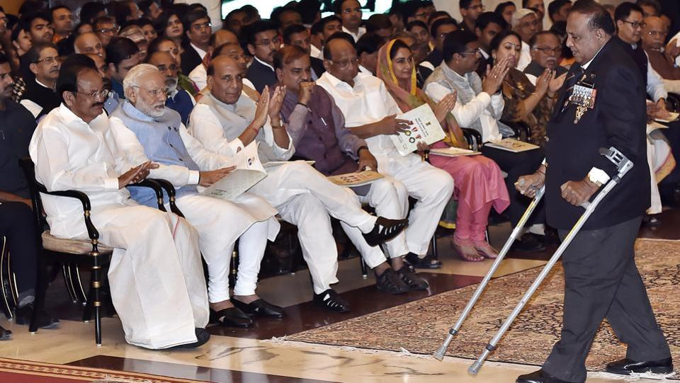 Vice President M. Venkaiah Naidu, Prime Minister Narendra Modi, Home Minister Rajnath Singh look on as Murlikant Rajaram Petkar India's first Paralympic gold medalist walks to receive the Padma Shri. This year 85 recipients were selected including two duo cases. This included 3 Padma Vibhushan, 9 Padma Bhushan and 73 Padma Shri awardees. Fourteen of the awardees were women, while 16 were foreigners and three being awarded posthumously. (Ajay Aggarwal / HT Photo)