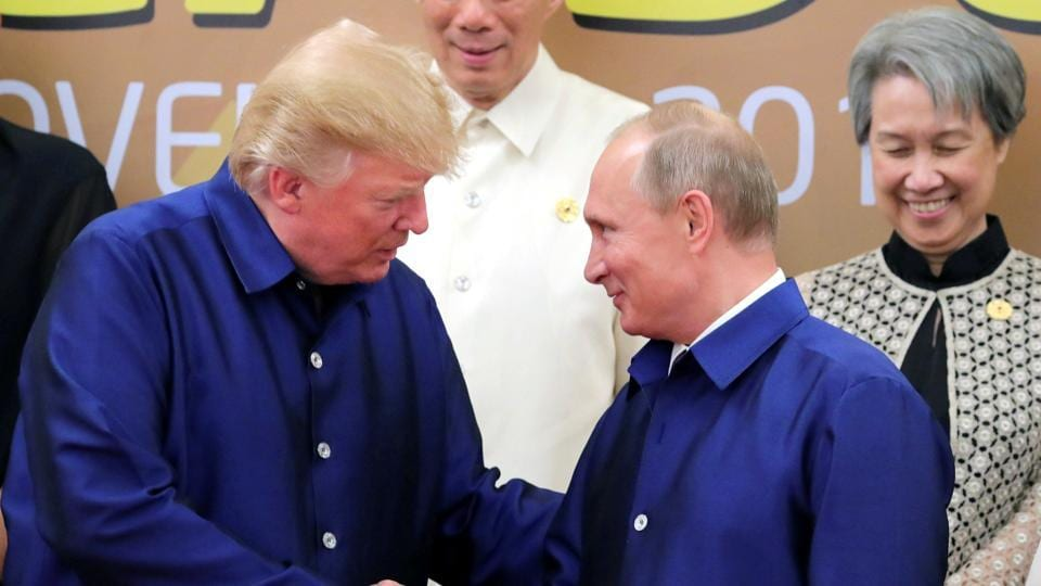 US president Donald Trump and Russian President Vladimir Putin shake hands during a photo session at the APEC summit in Danang, Vietnam on November 10, 2017.