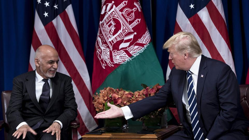 Afghanistan's President Ashraf Ghani and US President Donald Trump shake hands before a meeting at the Palace Hotel during the 72nd United Nations General Assembly September 21, 2017 in New York City.