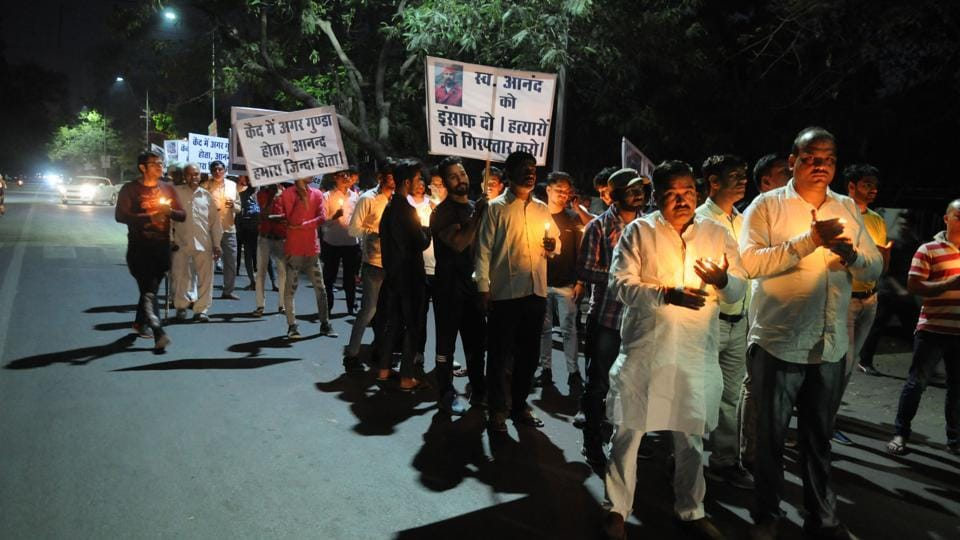 Badshahpur residents held a candlelight march on Wednesday demanding the arrest of the main accused for the murder of Anand Vashisht.