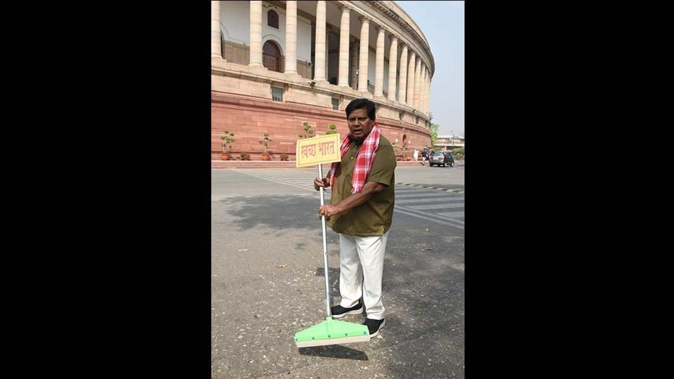 In his most recent appearance at Parliament he was seen continuing this protest dressed as a Swachh Bharat worker armed with a wiper on March 22. (Arvind Yadav/ HT Photo)