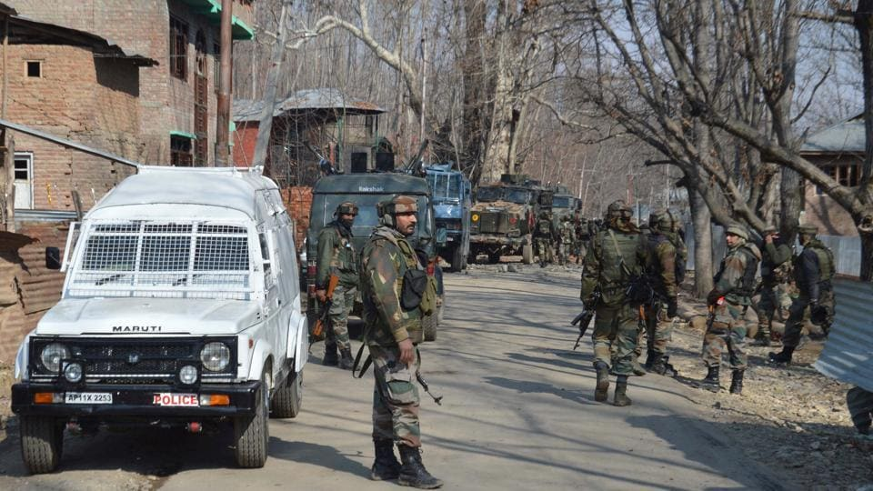 Army soldiers near the site of gunfight at village Frisal in Kulgam some 70 kilometres south of Srinagar,on February 12, 2017. Militant groups often abduct, torture and kill people they suspect of working as informers for security  forces.