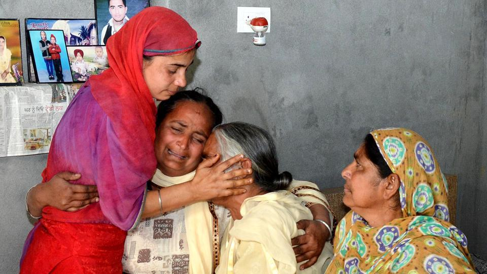 Harjit Kaur (L) with her mother-in-law Joginder Kaur (C) mourns the death of her husband Gurcharan Singh who was killed along with 39 Indians who went missing in Iraq in 2014, at Jalal Usma village near Amritsar on Tuesday. (Sameer Sehgal / HT Photo)