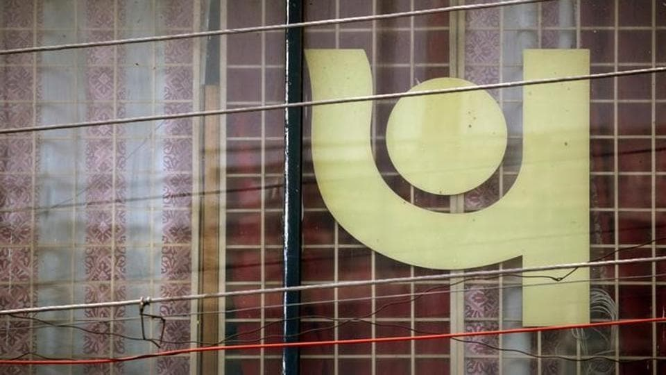 The logo of Punjab National Bank (PNB) is seen on a branch office window in New Delhi on February 27.