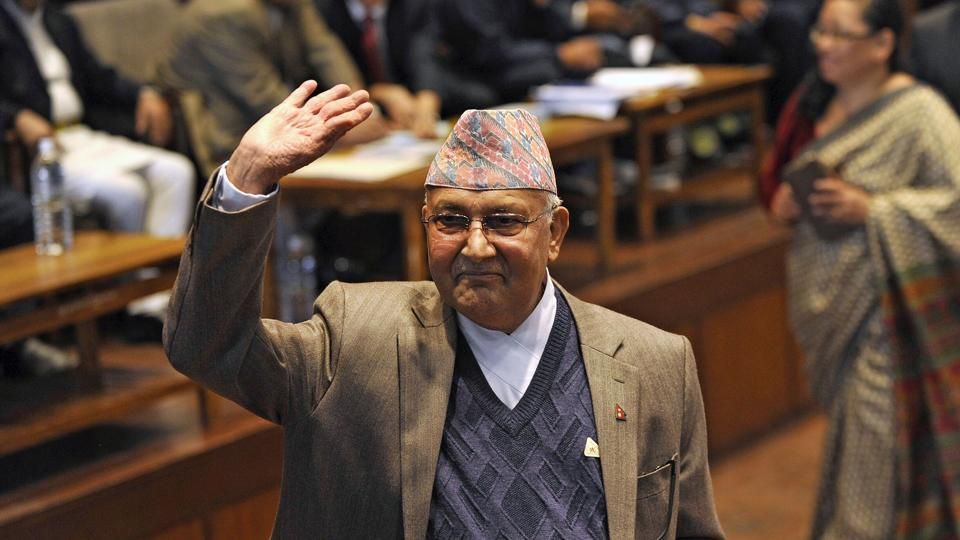 Nepal's Prime Minister KP Sharma Oli waves after casting his vote in an election for Nepal's new president in Kathmandu.