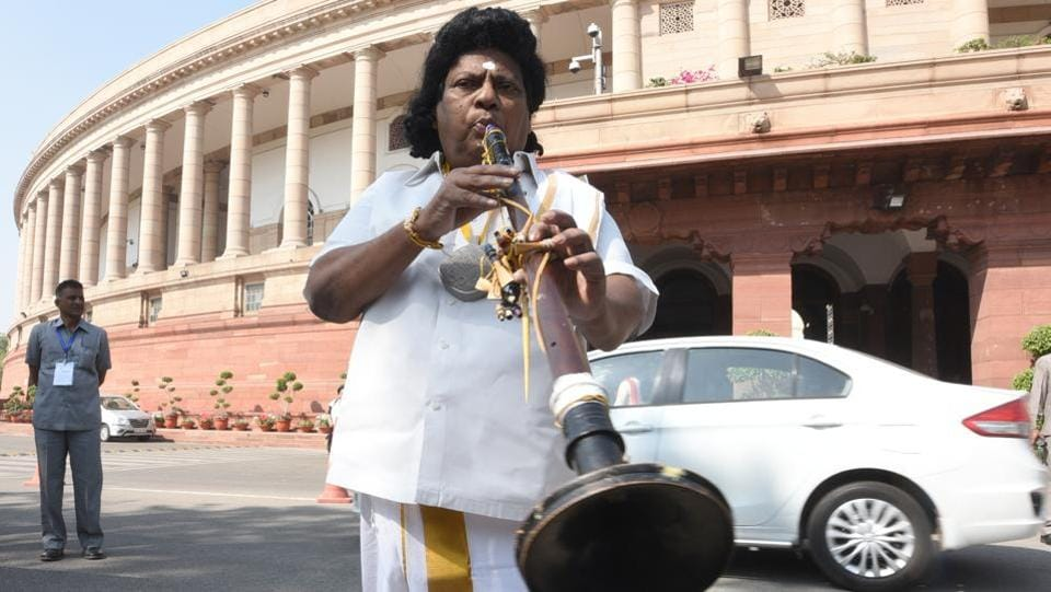 Insisting on the special category status to Andhra Pradesh, Chief Minister N Chandrababu Naidu on March 12, urged Prime Minister Modi to honour promises made by the centre at the time of bifurcation of the state. In support, N. Sivaprasad staged a protest outside the parliament as a 'nadaswaram' player. (Sonu Mehta / HT Photo)