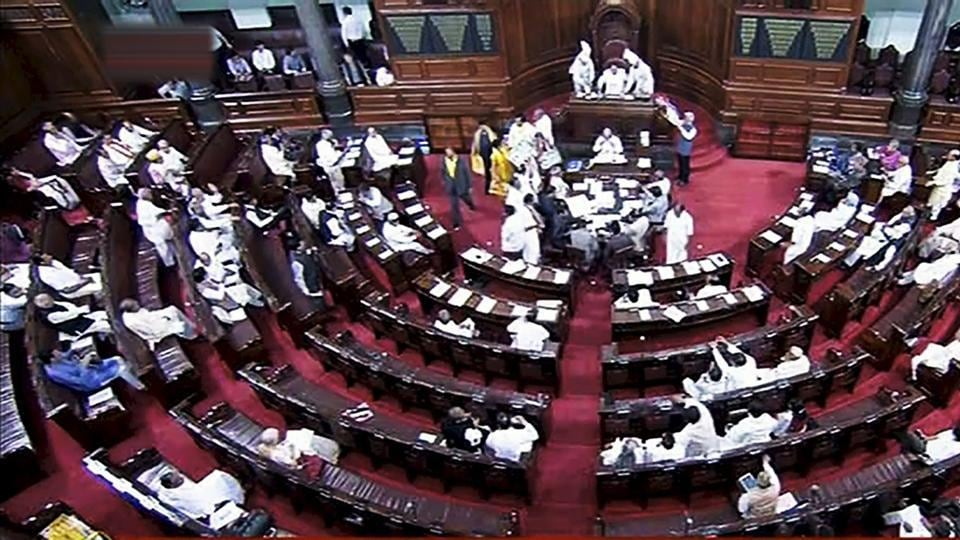 Opposition members protest during the on-going budget session of Rajya Sabha, at Parliament House in New Delhi on Monday.