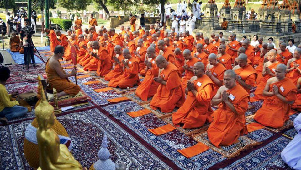 Members of Royal Thai Police get ordained under the Bodhi tree at Mahabodhi Temple in Bodh Gaya on Thursday. (PTI)