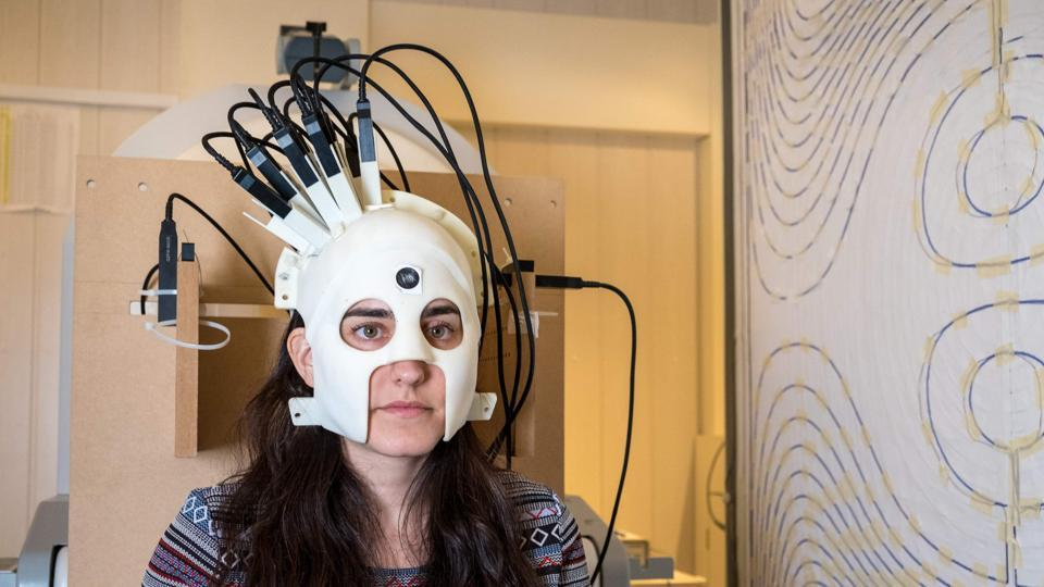 A handout photo released on March 21, 2018, via Nature from Wellcome shows a woman with the new brain scanner.