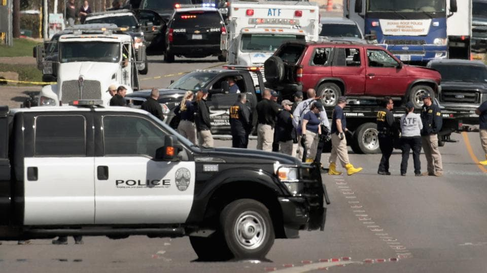 The vehicle that the Austin package bomber, Mark Anthony Conditt, was driving when he blew himself up is towed from the crime scene along Interstate 35 in suburban Austin on Wednesday in Round Rock, Texas.