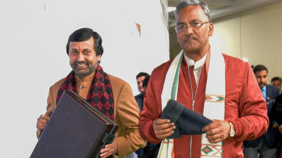 Chief minister Trivendra Singh Rawat (R) and finance minister Prakash Pant arrive to present the budget during the budget session of the state assembly on Thursday.