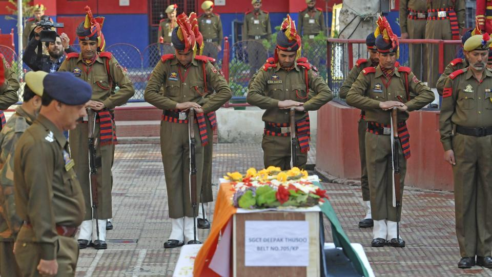 Policemen pay respects during the wreath laying ceremony of their colleague Deepak Thusoo, who was killed in a gun battle with militants, at the police headquarters in Srinagar. In the bloodiest encounter in Kashmir so far this year, two policemen, three soldiers and five militants suspected to have recently crossed the Line of Control were killed in a gunbattle in a forest in Kupwara district on Wednesday. (Waseem Andrabi / HT Photo)