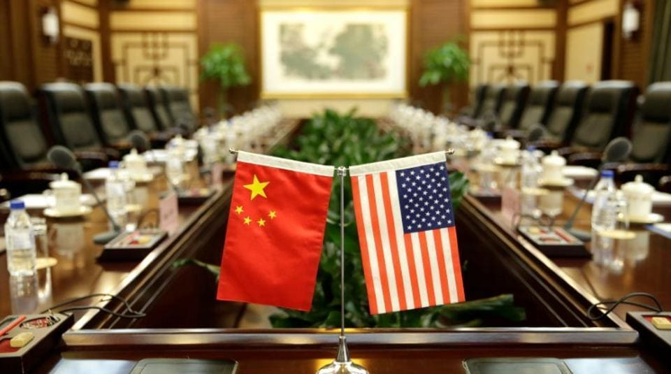 Flags of the US and China are placed for a meeting between officials of the two countries in Beijing.