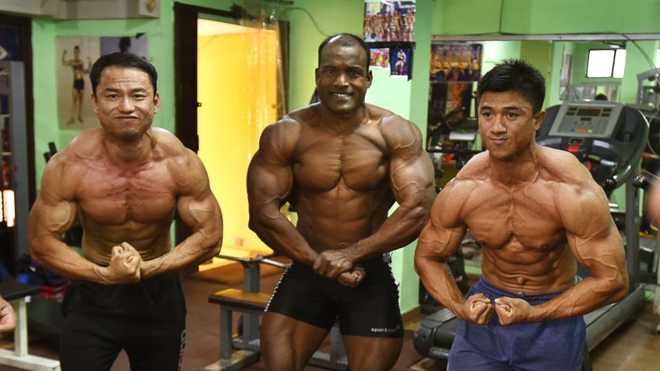 "Aspiring to a title also nurtures a positive self-image along with obvious gains to their physiques. Malem Lemba (L), a CRPF constable said, ""I used to be overweight during my school days but taking inspiration from my friends, I became a member of a local gym in Manipur. I joined the force in 2017 and ever since, I have been training myself for this championship."" (Raj K Raj / HT Photo)"
