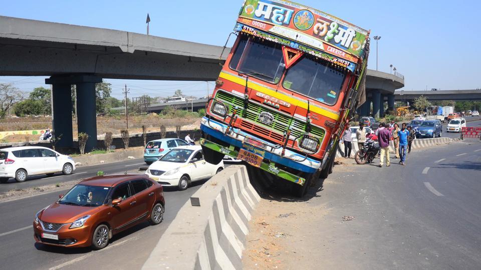 A truck climbed onto the divider near Turbhe Flyover  in Navi Mumbai on Thursday.