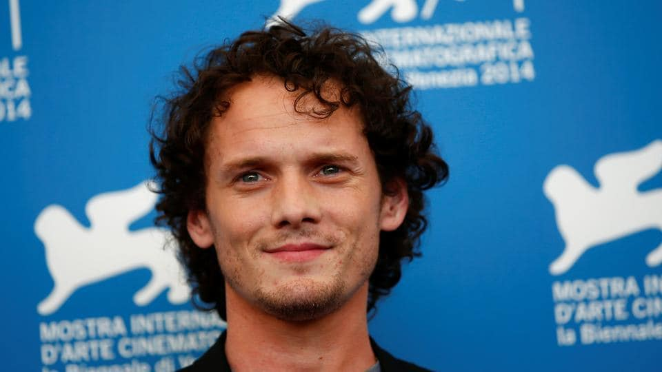 Anton Yelchin poses during the photo call for the movie Burying the Ex at the 71st Venice Film Festival.