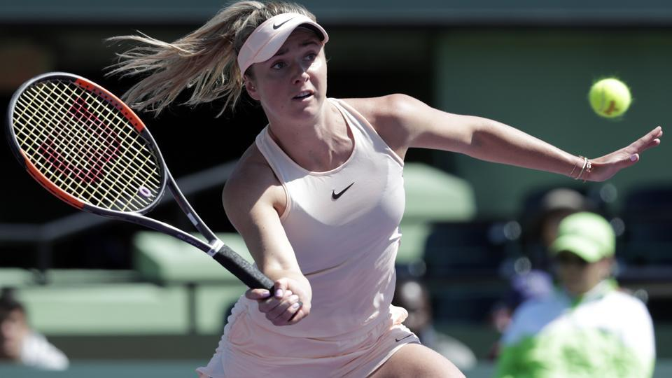 Elina Svitolina returns to Naomi Osaka during the Miami Open tennis tournament on Friday.